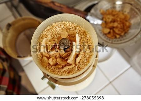 Making grround fried garlic and shrimp crackers - stock photo