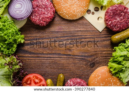 Making hamburger, background with copy space for recipe.Flat lay from above. - stock photo