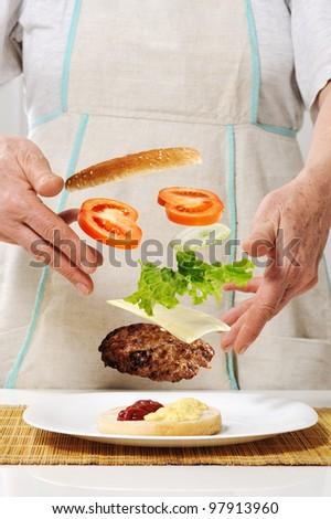 Making hamburger ingredients concept - stock photo
