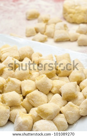 Making handmade gnocchi inside restaurant kitchen. Work in progress with an italian recipe. - stock photo
