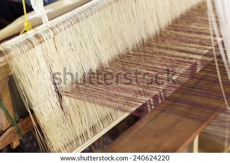 making handmade weaving thread - stock photo