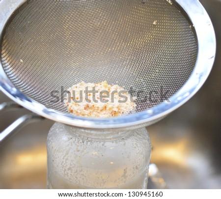 Making homemade almond milk - stock photo