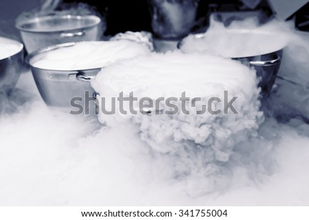 Making ice cream with liquid nitrogen, professional cooking - stock photo