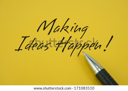 Making Ideas Happen! note with pen on yellow background - stock photo