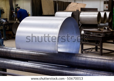 Making metal pipes and tubes in an engineering factory
