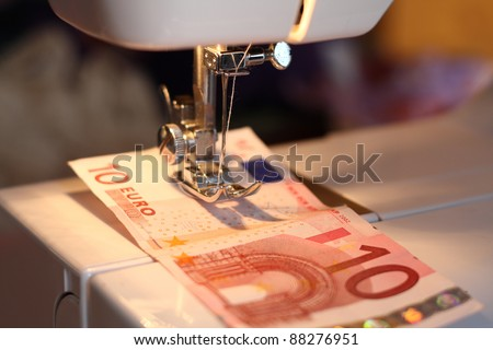 Making money with a sewing machine - stock photo