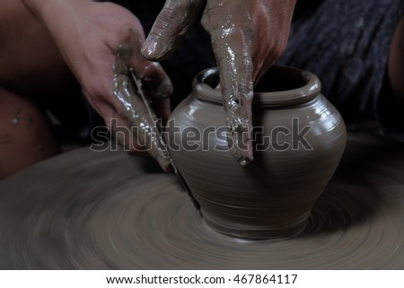 Making of clay pot with pottery wheel