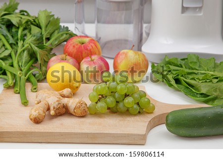 Making of healthy green juice - stock photo