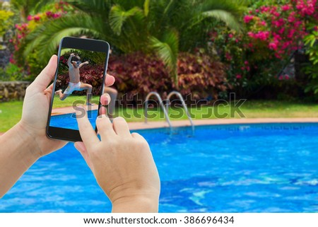 making photo of boy jumping in cool water of swimming pool - stock photo