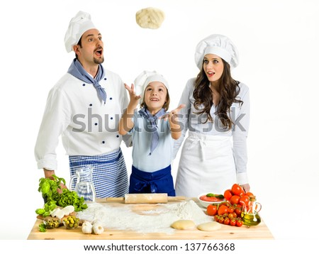 Making pizza with the family - stock photo