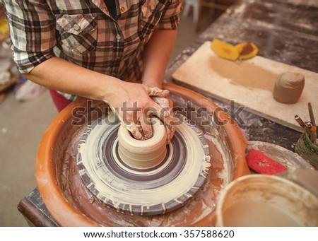 Making pottery - stock photo