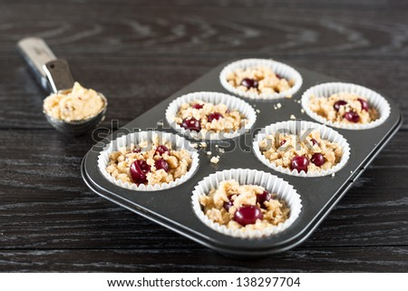 Making Red Currant Muffins - stock photo