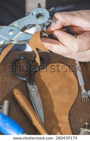 Making shoes manual. Leather sandals - stock photo