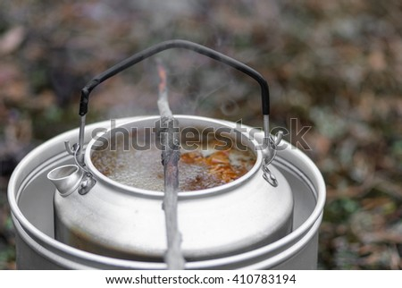 Making soup in Finnish woods on a hiking trip - stock photo