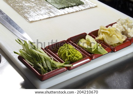 Making sushi roll - stock photo