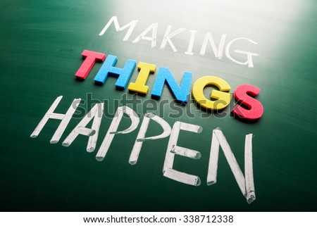 Making things happen concept words on blackboard - stock photo
