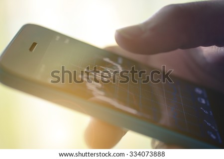 Making trading online on the smart phone. New ways to make economy and trading - stock photo