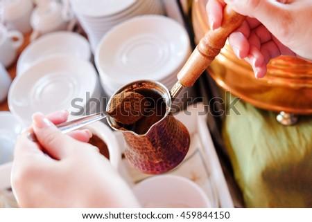Making traditional greek / turkish black coffee on sand - stock photo