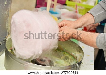 making white cotton candy in cotton candy machine - stock photo