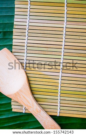 Makisu sushi cookware on banana leaf