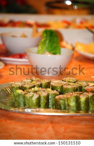 Makizushi A plate on a table with many delicious makizushi.  - stock photo
