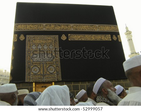 MAKKAH - JAN 2 : A close up view of kaaba door and the kiswah (cloth that covers the kaaba) at Masjidil Haram on Jan 2, 2008 in Makkah, Saudi Arabia. The door is made of pure gold. - stock photo