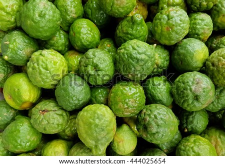 Makrut (kaffir) limes, used in oriental and indian cooking - stock photo