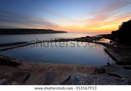 Malabar pool viewed from cliff above with a dawn sky just starting to colour up