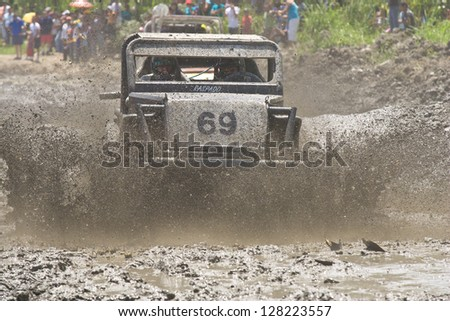 MALACATOES LOJA ECUADOR FEB 10 2013. Custom 4X4 race on riverside Malacatoes Southern Ecuador Feb 10 2013. #69 in the mud