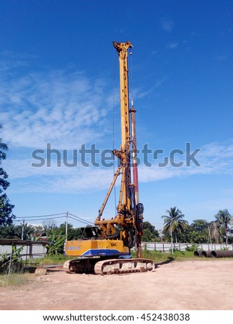 MALACCA, MALAYSIA -MARCH 12, 2016: Bore pile rig machine at the construction site in Malacca, Malaysia. The machine used to driven pile for building foundation work.
