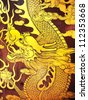 MALACCA, MALAYSIA - MAY 21: Golden dragon painting on the wall of Cheng Hoon Teng Temple on May 21, 2012 in Malacca. The architectural style is from southern China in the early 17th century. - stock photo