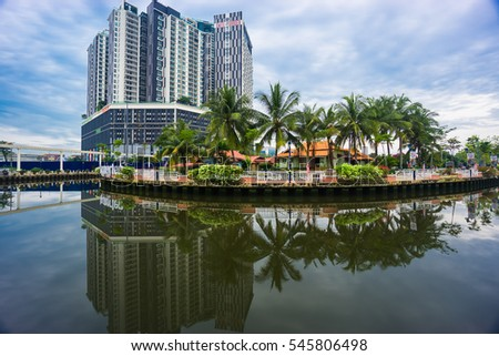 MALACCA, MALAYSIA - OCT 20, 2016 : Cruise tour boat sails on the Malacca River in Malacca during cloudy weather. Rehabilitation of the Malacca River to develop river tourism started in July 2002