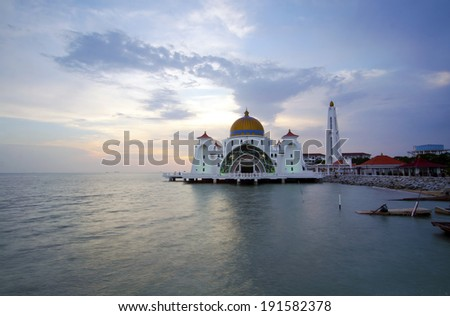 Malacca Straits Mosque (Masjid Selat Melaka) is a mosque located on Malacca Island near Malacca Town in Malacca state, Malaysia.Scenery during sunset. - stock photo