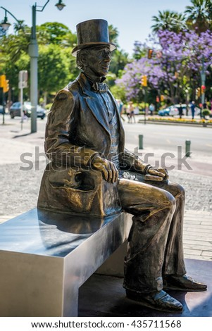 MALAGA, ANDALUCIA/SPAIN - MAY 25 : Statue of Danish Writer Hans Christian Andersen in Malaga Spain on May 25, 2016. Unidentified people