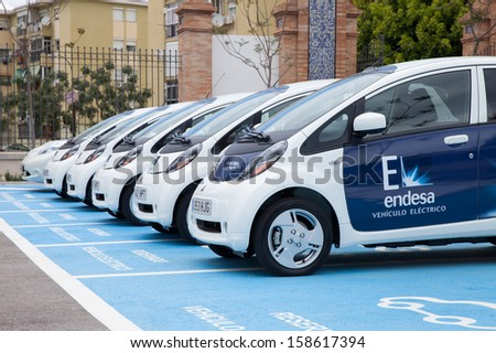 Malaga, Spain: April 28, 2013 - Electric Vehicles. Spain is one of the leading wind power producers in the world; Mitsubishi Miev and Nissan Leaf are the leading electric cars in the world as of 2013