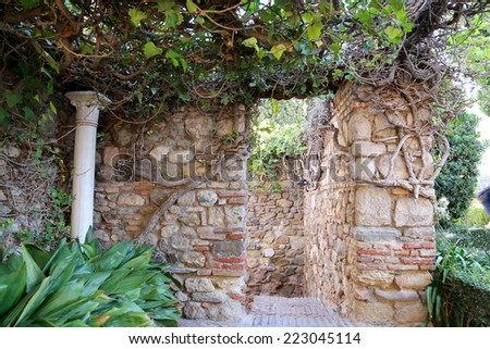 MALAGA, SPAIN- AUGUST 23, 2014: Alcazaba castle on Gibralfaro mountain. Malaga, Andalusia, Spain. The place is declared UNESCO World Heritage Site