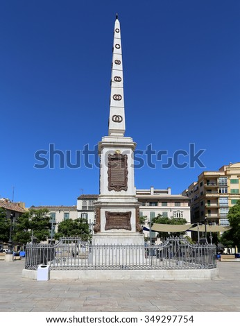 MALAGA, SPAIN- AUGUST 23, 2014: Plaza de la Merced in Malaga, Andalusia, Spain. In this square, one of the main squares in the center of the city, there is the obelisk in honor of General Torrijos