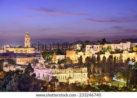 Malaga, Spain cityscape at the Cathedral, City Hall and Alcazaba Moorish fort. - stock photo