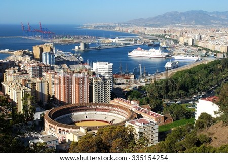 MALAGA, SPAIN - JULY 11, 2008 - Elevated view of the bullring and port area, Malaga, Malaga Province, Andalusia, Spain, Western Europe, July 11, 2008. - stock photo