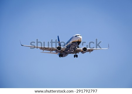 MALAGA, SPAIN - JUNE 23: Ryan Air plane approaching to landing track at AGP Airport on June 23, 2015. Ryan Air is an Irish low-cost airline.