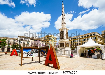 MALAGA,SPAIN - 28 MAY 2016:Famous Merced square under blue sky  - stock photo