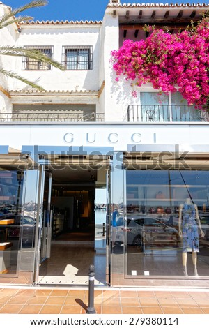 MALAGA, SPAIN - MAY 9: Outside of the Gucci store pictured on May 9th, 2015 in Malaga, Spain. The fashion company founded in 1921 is among most recognized luxury brands in the world. - stock photo