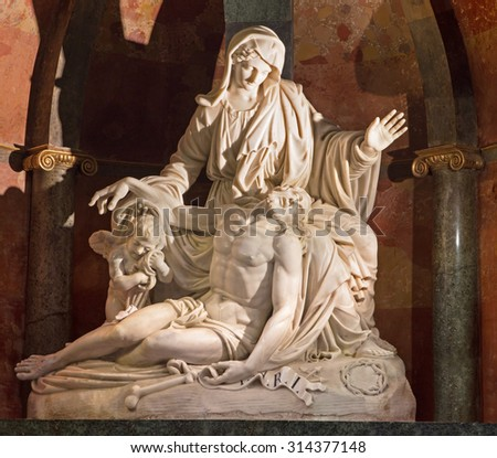 MALAGA, SPAIN - MAY 31, 2015: The white marble Pieta by Pisani brothers (1802) in the Cathedral.
