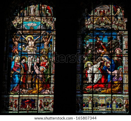 MALAGA, SPAIN - NOV 29: Stained glass window depicting Jesus on the cross (left) and on the Via Dolorosa (right) on Good Friday, in the cathedral of Malaga, Spain, on November 29, 2013.  - stock photo