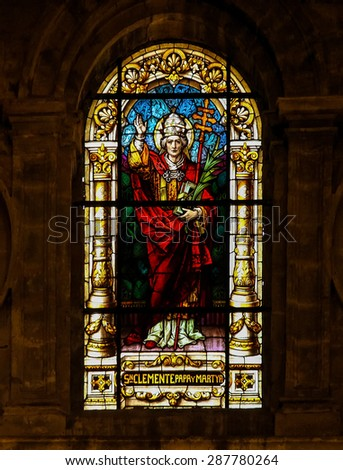MALAGA, SPAIN - NOVEMBER 29, 2013: Stained glass window depicting Pope Clement I, bishop of Rome from 92 to 99, martyr and patron saint of mariners, in the cathedral of Malaga, Spain. - stock photo