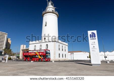 MALAGA, SPAIN - SEPTEMBER 4 2014: White lighthouse and turistic bus - stock photo