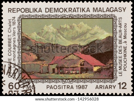 "MALAGASY - CIRCA 1987: A stamp printed in the MALAGASY, shows ""Chalet in the Mountains"" (1874) by G.Courbet, circa 1987"