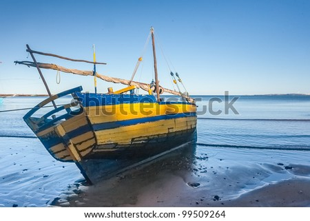Malagasy dhow at low tide of Analalava, western Madagascar - stock photo