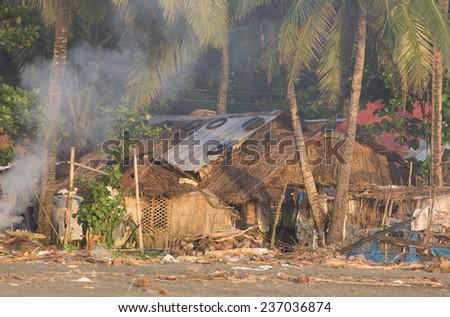 Malandog, Philippines - October 20, 2014: Poor people housing and Datu sumankwel beach on Panay island - stock photo