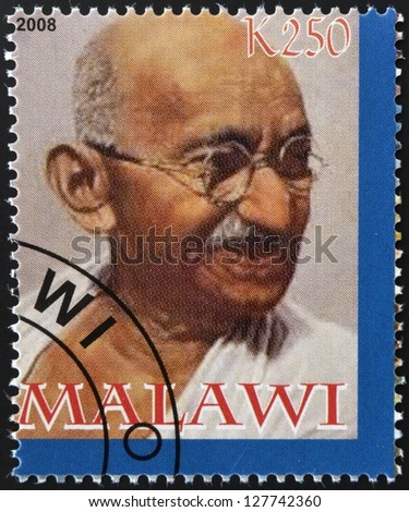 MALAWI - CIRCA 2004: A stamp printed in Malawi shows Mohandas Karamchand Gandhi, circa 2004 - stock photo